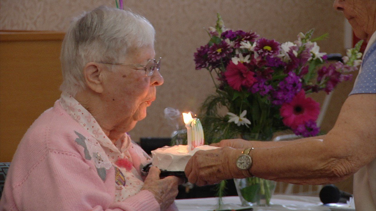 Ruth Clemens blows out candles during her 100th birthday party at the Missoula Manor.