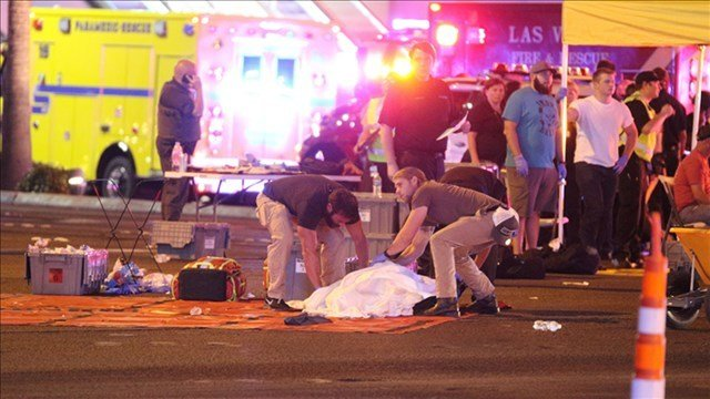Police officers and first responders at the scene of the mass shooting in Las Vegas. Credit: ZUMA Press