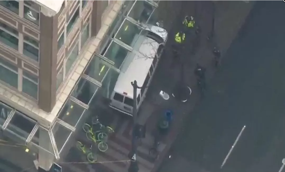 4 treated after van jumps curb, hits building in downtown Seattle