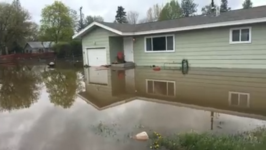 Flooding on Nancy Lou Drive, one of the evacuated areas in Missoula.