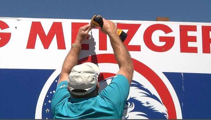 Greg Metzger takes down one of his campaign signs in Bozeman after winning the Clerk and Recorder's nomination by 6 votes.