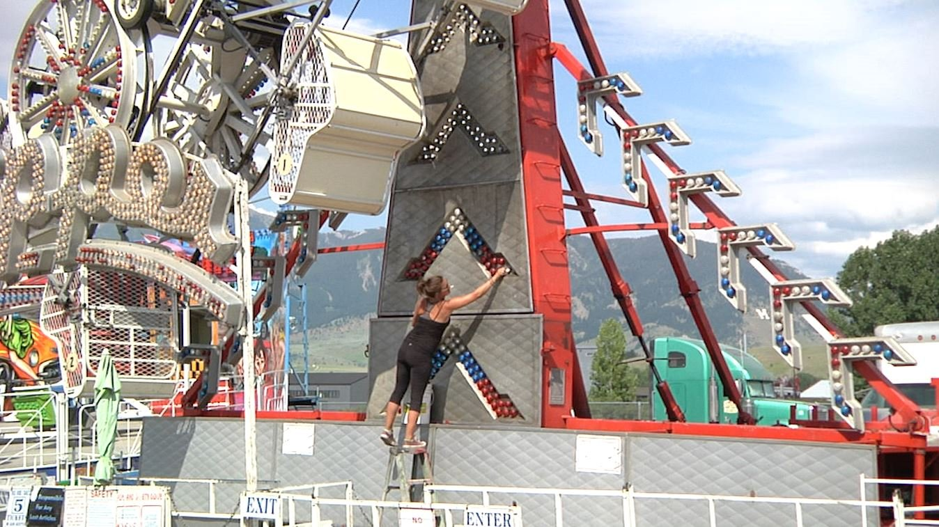 Workers put finishing touches on attractions for the Big Sky Country State Fair in Bozeman. July 17, 2018.