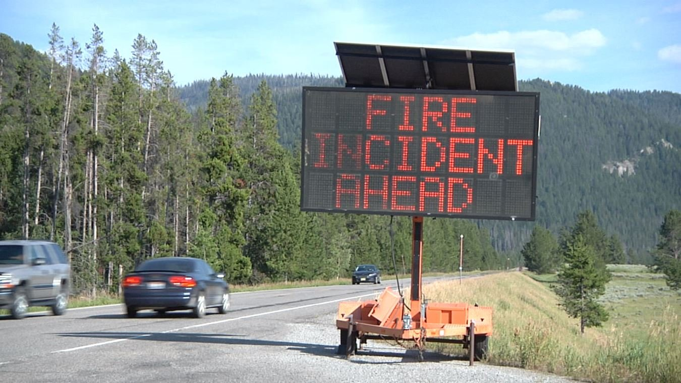 A sign warns visitors to Yellowstone National Park about the Bacon Rind Fire. August 6, 2018.