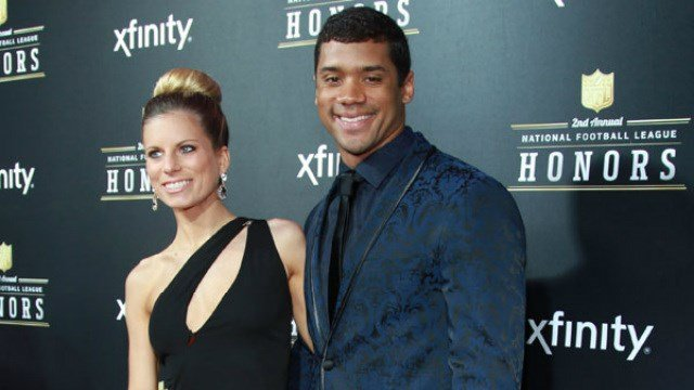 Russel and Ashton Wilson once looked like a happy young couple, now they are headed towards a split. (Photo: Seahawks.com)
