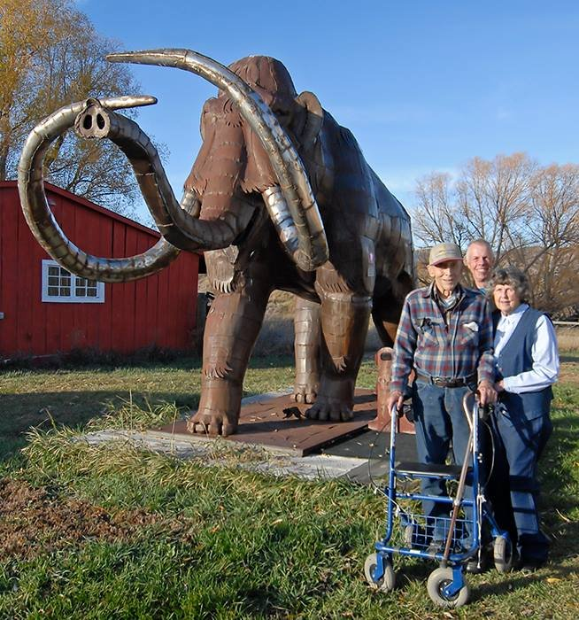 The Ohrmann family posing in front of the steel mammoth