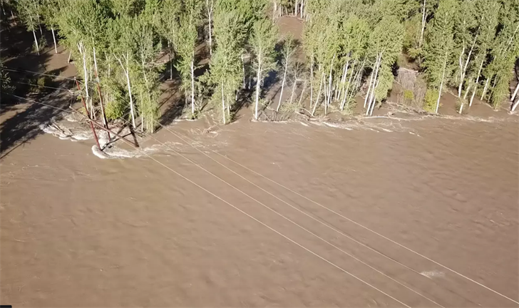 file photo: Tipped power lines in Clark Fork spring flooding